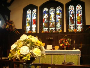The altar at St Oswald's decorated for Harvest