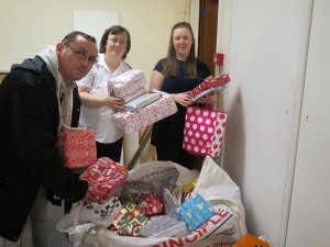 Members of the Salvation Army in Northwich receiving gifts for distribution