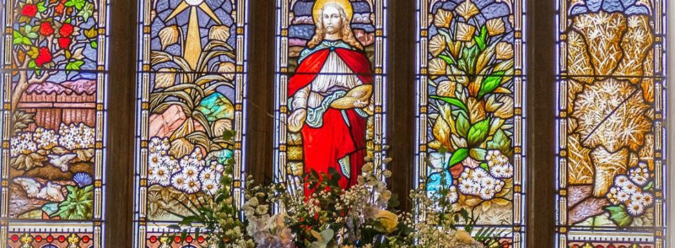 West window with flower arrangement