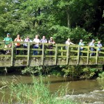 Group of walkers on bridge