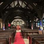 St Oswald interior with banners and Taize Cross